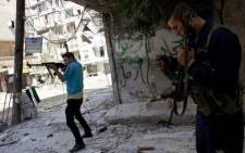 Syrian rebels take position in the Salaheddin district of the northern city of Aleppo on September 6, 2012. Picture: AFP.