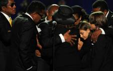Michael Jackson's siblings comfort his children during his memorial at the Staples Centre in Los Angeles. Picture: Gallo/Getty Images