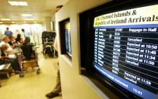 Monitors show cancelled and delayed flights at a London Heathrow airport terminal. Picture: AFP