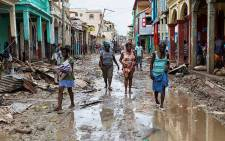 People walk along a street in downtown Jeremie Haiti, Thursday October 6, 2016. Hurricane Matthew passed over Haiti on Tuesday October 4, 2016, with heavy rains and winds. While the capital Port au Prince was mostly spared from the full strength of the class 4 hurricane, the western cities of Les Cayes and Jeremie received the full force sustaining wind and water damage across wide areas. Picture: The United Nations Stabilization Mission in Haiti (MINUSTAH) Facebook page.