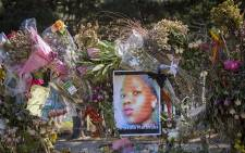 A photograph of Khayelitsha teenager Sinoxolo Mafevuka on the fence of the Lower Tokai Park after mourners left tributes to murdered girls on 15 March 2016. Picture: Aletta Harrison/EWN.
