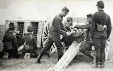 A picture of a post card released by the Historial de Peronne, Museum of WW1, shows French artillery soldiers with a 75 mm cannon in 1914 during the First World War. Picture: AFP.