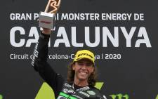 CIP Green Power rider Darryn Binder of South Africa celebrates on the podium after winning the Moto3 race of the Moto Grand Prix de Catalunya at the Circuit de Catalunya on 27 September 2020 in Montmelo on the outskirts of Barcelona. Picture: AFP
