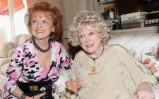 Actress Elaine Dupont (L) and comedian Phyllis Diller celebrates the 25th wedding anniversary of Zsa Zsa Gabor and Prince Frederic von Anhalt at their home on August 14, 2011. Picture: AFP.