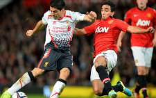 Manchester United's Brazilian defender Rafael vies with Liverpool's Uruguayan forward Luis Suárez during the League Cup football match between Manchester United and Liverpool at Old Trafford in Manchester on September 25, 2013. Picture: AFP