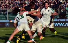 South Africa's Springboks' lock Eben Etzebeth (R) is tackled by Italy's centre Michele Campagnaro during the rugby union Test Match between Italy and South Africa, on November 22, 2014 at the Euganeo stadium in Padua. AFP
