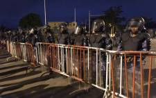 Anti-riot policemen block the road against opposition supporters keeping an all-night vigil to press for constitutional reform, during anti-government protests led by a coalition of opposition parties in Lome, on 7 September, 2017. Picture: AFP