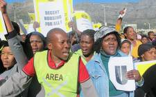 Municipal workers march for better wages and housing allowances.
