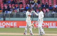 South Africa's Dean Elgar (left) and Quinton de Kock (right) celebrate a milestone on day three of the first Test against India in Visakhapatnam on 4 October 2019. Picture: @BCCI/Twitter