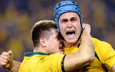FILE: Australian Wallabies captain James Horwill and flyhalf James O'Connor celebrate after defeating the British and Irish Lions in the second rugby test match, in Melbourne on  29 June 2013.