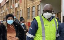 Gauteng Premier David_Makhura and Health MEC, Dr Nomathemba Mokgethi arrive at Mponeng Vaccination Site, Harmony Gold to assess employer-based vaccination sites on 13 August 2021. Picture: @GautengProvince/Twitter.