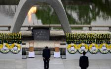 Japanese Prime Minister Shinzo Abe (C) bows in front of the Memorial Cenotaph after delivering a speech during the 75th anniversary memorial service for atomic bomb victims at the Peace Memorial Park in Hiroshima on 6 August 2020. Picture: AFP