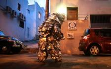 Artist and performer, Francois Knoetze's creates unique body suits out of trash. His works have been showcased on his short films and exhibitions around the country as part of his Cape Mongo project. Picture: Thomas Holder/EWN