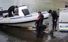 SAPS officials search for a missing Hangberg fisherman Durick van Blerk. Picture: Bertram Malgas/EWN