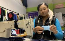 A volunteer with the Delft Action Network sews up a mask. Picture: Kaylynn Palm/EWN