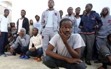 FILE: African migrants who were either rescued from the Mediterranean Sea or prevented from crossing to Europe by Libyan coast guards wait at a detention centre in Zawiyah, 45 kilometres west of the Libyan capital, Tripoli, on 18 April 2017. Picture: AFP.