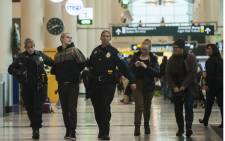 A person, arrested at a Black Lives Matter protest at the Minneapolis-St. Paul International Airport, is walked by police to a detainment room on December 23, 2015 in Bloomington, Minnesota. Picture:AFP