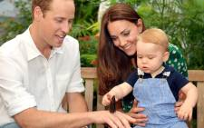 A photograph taken in London on Wednesday 2 July, 2014, to mark Britains Prince Georges first birthday, shows Prince William (L) and Catherine, Duchess of Cambridge with Prince George during a visit to the Sensational Butterflies exhibition at the Natural History Museum in London. Picture: AFP