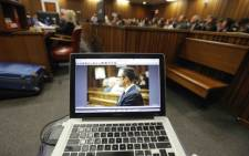 A photograph of Oscar Pistorius is seen on the laptop of a court pool photographer during the athlete's murder trial in the North Gauteng High Court. Picture: Pool.