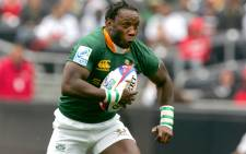 FILE: Gcobani Bobo runs with the ball against Fiji during the second day of matches of the IRB Sevens World Series in February 2007 in San Diego, California. Picture: AFP.