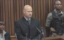 Colonel Ian van der Nest gives his testimony at the High Court in Pretoria during the Oscar Pistorius murder trial on 19 March 2014.