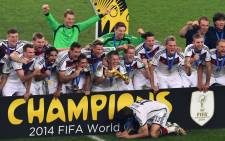 Germany's players celebrate after winning the final football match between Germany and Argentina at the Fifa World Cup in Rio de Janeiro on 13 July, 2014. Picture: AFP.