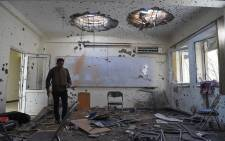 A journalist walks inside of a damaged class of the National Legal Training center, a day after gunmen stormed Kabul University in Kabul on 3 November 2020.  Picture: AFP