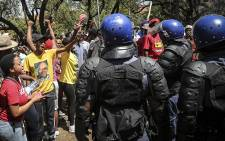Police negotiated with University of the Free State students to disperse after they vandalised a statue of apartheid era leader CR Swart. Picture: Reinart Toerien/EWN.
