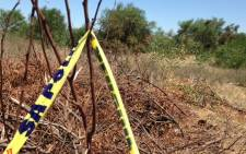 Police tape on the scene where six male bodies were found dumped on 10 December 2014. Picture: Lauren Isaacs/EWN.