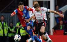 Liverpool's captain, Steven Gerrard battles with Crystal Palace's defender during their English Premier League match on 5 May 2014. Picture: Facebook.