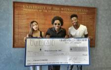 SA rapper Ifani hands over a R50 000 cheque which will go toward Wits University's Access campaign. Picture: Twitter
