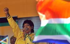 In this file photo taken on 4 June 2010 South African MP Winnie Madikizela-Mandela addresses members of South Africa's ruling party African National Congress (ANC) during a street party to celebrate six days left to the opening of the 2010 Fifa World Cup in Johannesburg. Picture: AFP