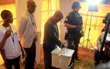 Lesotho Prime Minister Tom Thabane (C) casts his ballot on 28 February, 2015 at a polling station on the outskirts of Maseru to vote in a snap election. Picture: AFP.