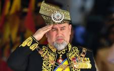 This file photo taken on 17 July 2018 shows the 15th king of Malaysia, Sultan Muhammad V, saluting a royal guard of honour during the opening ceremony of the parliament in Kuala Lumpur. Picture: AFP.