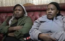 Shaun Mashego's sister Maria (left) and mother Kedibone talking about their loss. Picture: Louise McAuliffe/EWN