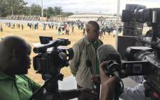 Amcu President Joseph Mathunjwa addresses the media at Masizakhele Stadium in Driefontein amid a strike in the gold sector. Picture: @_AMCU/Twitter