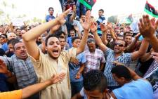 FILE: Libyans take part in a demonstration in the capital Tripoli on 31 July 2014, calling for international intervention to protect civilians. Picture: AFP.