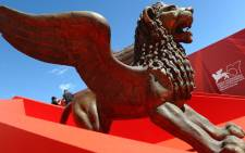 A statue of a Lion is exhibited near the Palazzo del Cinema for the Venice Film Festival. Picture: AFP.