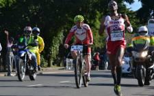 Comrades winner Ludwick Mamabolo strides confidently past the 8 kilometre mark on 3 June 2012. Picture: Aletta Gardner/EWN