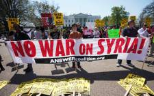 Demonstrators take part in a protest against the US bombing of Syria in front of the White House on 14 April 2018 in Washington, DC. Picture: AFP.