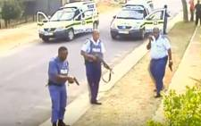 Screengrab of police officers who have been arrested for the murder of 32-year-old Khulekani Mpanza, who was caught by police for an attempted robbery.