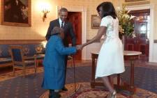Virginia McLaurin (106) meets President Barack Obama & his wife Michelle at the White House on 21 February 2014.