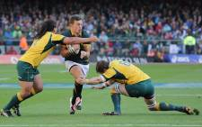 Handre Pollard braces ahead of being tackled during the Springboks' Rugby Championship match against Australia at Newlands on 27 September 2014. Picture: Aletta Gardner/EWN