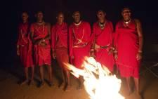 Maasai tribe members gather around a bonfire. Picture: Christa Eybers/EWN