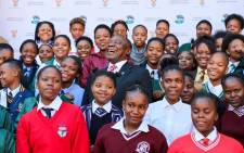 President Cyril Ramaphosa interacts with schoolgirls at the Union Buildings on Take a Girl Child to Work Day. Picture: Kayleen Morgan /EWN.