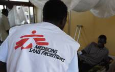 This file photo shows a member of Medecins Sans Frontieres (MSF, Doctors Without Borders) takes care of a wounded man on at Bangui's general hospital in the Central African Republic. Picture: AFP