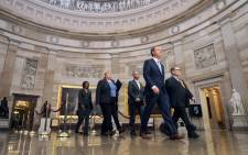 Some of the members of Congress appointed as managers of the impeachment trial of President Donald Trump walk through the Rotunda of the US Capitol on their way to the US Senate 16 January 2020 in Washington, DC. Picture: AFP