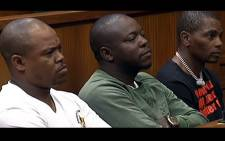 A screengrab shows the three JMPD officers who were found not guilty murder in the High Court in Johannesburg. Picture: SABC Digital News/youtube.com
