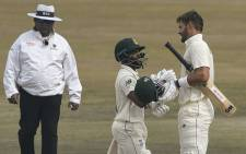 South Africa's Aiden Markram (R) celebrates with teammate Temba Bavuma (C) after scoring a century (100 runs) during the fifth and final day of the second Test cricket match between Pakistan and South Africa at the Rawalpindi Cricket Stadium in Rawalpindi on 8 February 2021. Picture: Aamir Qureshi/AFP