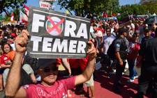 Residents of Rio de Janeiro demonstrate against interim president Michel Temer, political upheaval, corruption and the cost of the Rio 2016 Olympics Games on 5 August 5, 2016. Picture: AFP.